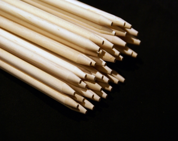 Stack of long birch wood dowels with a blunt point on one end