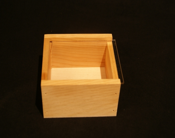 Custom wood box with Plexiglas sliding top.