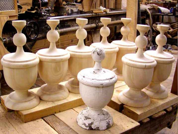 Grouping of unfinished wood finials that were custom made to match a customer sample.